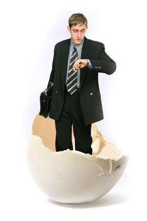 tojáshéj: Businessman standing in a big egg shell Stock fotó