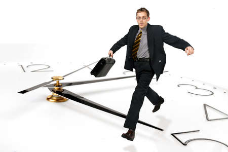Businessman running on clock Stock Photo