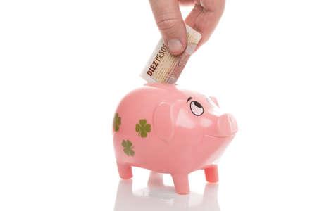 pesos: Pink Money Pigg with Argentina Pesos Stock Photo