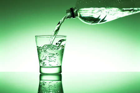 purely: A glass of fresh water with a bottle