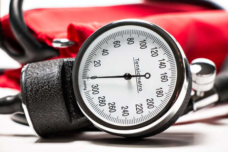 blood pressure cuff: red Blood pressure cuff, close-up isolated