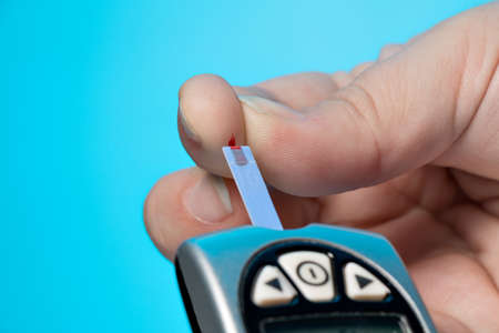 blood glucose: Glucose concentration in the blood test with a blood glucose meter Stock Photo