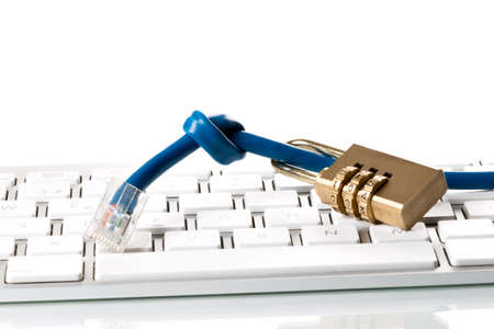 trojans: on computer keyboard lying  a combination lock and a USB flash drive