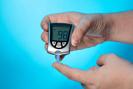 Glucose concentration in the blood test with a blood glucose meter Stock Photo