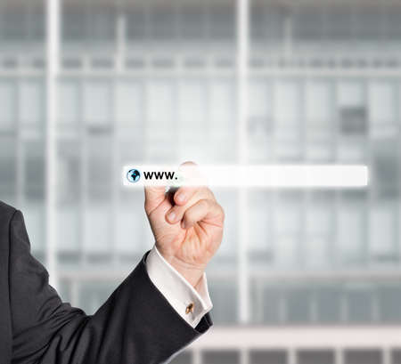 internationally: businessman touching web browser address bar with www sign