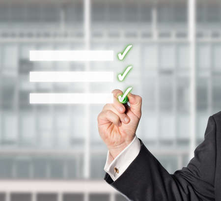 auditors: businessman hooked a Virtual check-list with a green check pen Stock Photo