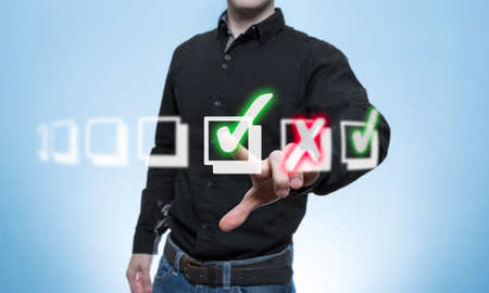 auditors: Man has made a virtual checklist with a green tick