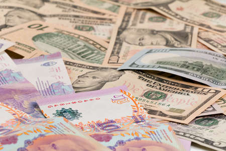 peso: Argentine peso and US dollar bills as a background