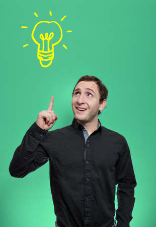 applicable: Young man lifts his finger and looking upward to a light bulb