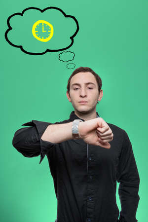 impatient: Young man looks at his watch and has a thought bubble with a clock on himself