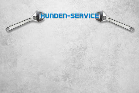 small business office: Wrench holds lettering customer service in front of a gray concrete wall Stock Photo