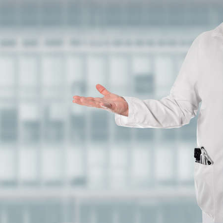 thumps up: Doctor in a white coat with a stethoscope and ophthalmoscope in your pocket, with a open hand