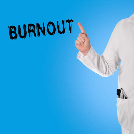 burnout: Doctor pointing at the word burnout, and in the pocket is a stethoscope and ophthalmoscope