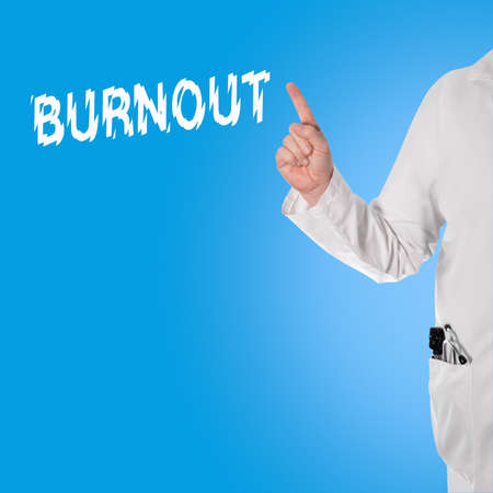 doctor burnout: Doctor pointing at the word burnout, and in the pocket is a stethoscope and ophthalmoscope