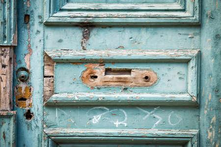 unoccupied: Old blue wooden front door, without door handles Stock Photo