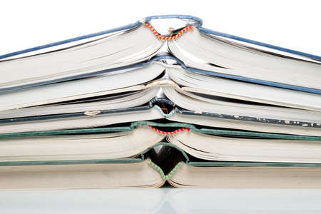lexicon: Many pitched books are placed in a stack