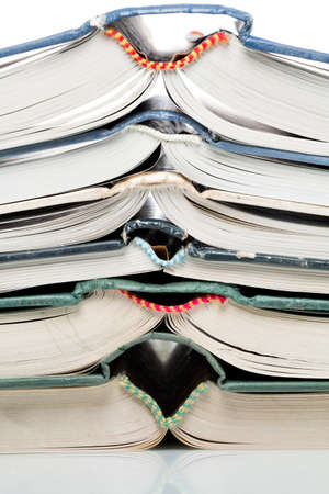 pitched: Many pitched books are placed in a stack