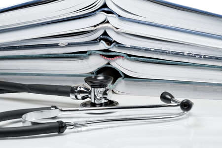 pitched: Many pitched books are placed in a stack and a stethoscope
