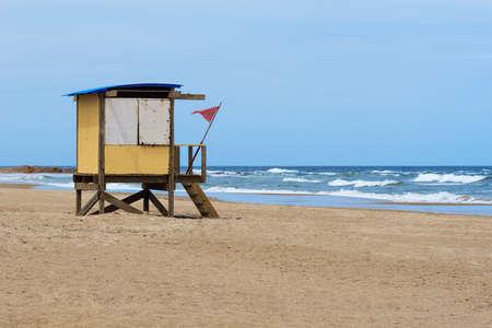 lonley: Lonley beach and lifeguard tower of Punta del Este Uruguay south America Stock Photo