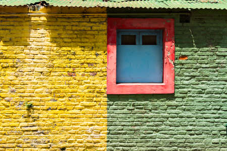 la boca: Colorful wall with windows in the neighborhood La Boca, Buenos Aires Argentine