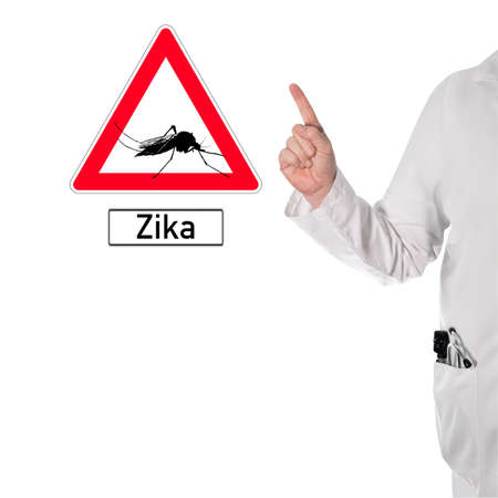 Doctor warns of dengue next to a sign with a mosquito and the text Zika Stock Photo