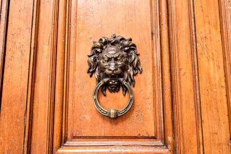 doorknocker: Old wooden door with a bronze lion Doorknocker Stock Photo