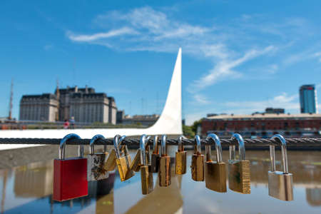 mujer: Womens Bridge with love locks in the harbor Puerto Madero Buenos Aires Argentine