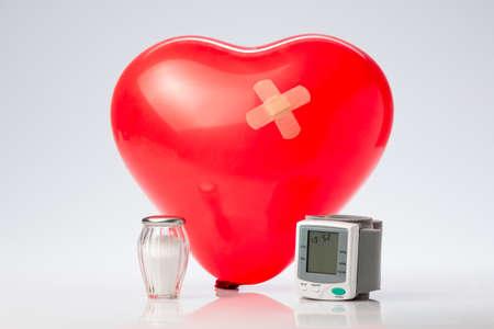 sphygmomanometer: Red balloon heart with a cross patch, salt spreaders and sphygmomanometer )Blood pressure meter)