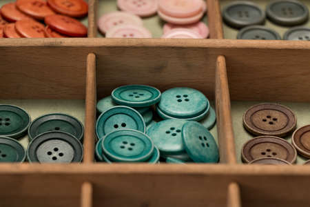blouses: many collected colorful buttons in a box Stock Photo