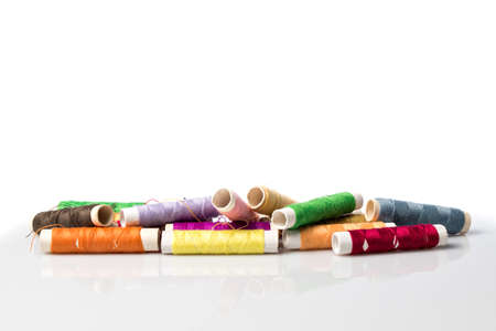 differently: Differently colored rolls sewing thread, on white Stock Photo