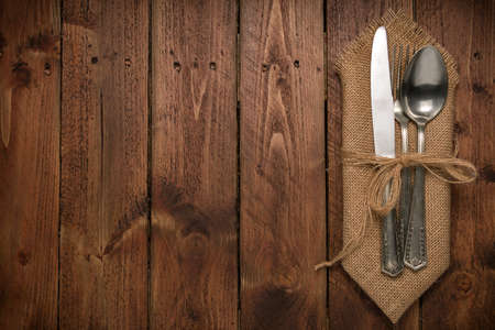 grunge cutlery: Cutlery is in a napkin wrapped on an old table
