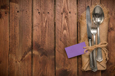 grunge silverware: Cutlery is in a napkin wrapped on an old table