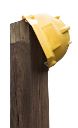 closing time: Yellow hardhat on a timber, with clipping Path Stock Photo