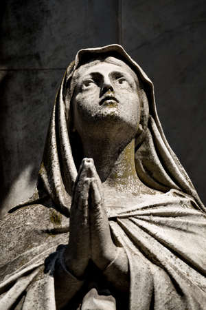 evita: Praying sculpture on the historic cementery Recoleta in Buenos Aires, Argentine