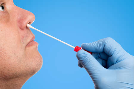 pcr: Doctor makes with a cotton swab a nasal bar test Stock Photo