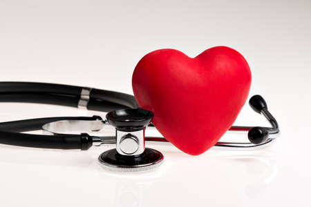 Stethoscope with red heart on white background