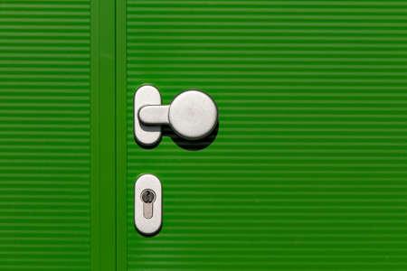 Green hall door with green door and silver colored door handle