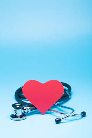 Stethoscope with red heart on blue background Stock Photo