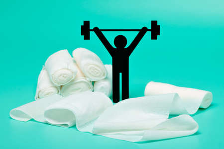Weight lifting pictogram, Plasters and bandages with Scissors and syringe on a white background