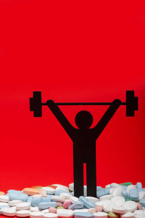 weight lifting pictogram with pills and red background