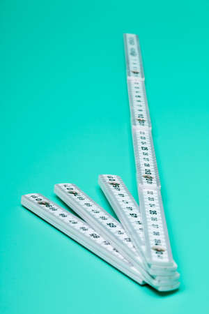 Inch rule on bright green background, Detail Stock Photo