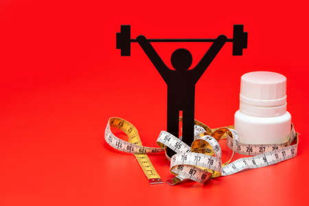 weight lifting pictogram with pills and tape measure, red background