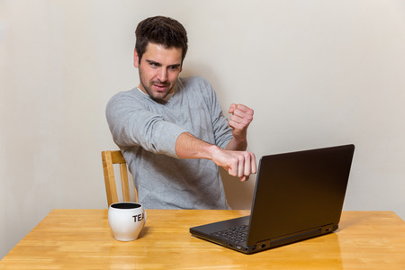 apparently: Man tries to hit his laptop screen he apparently got problems with it