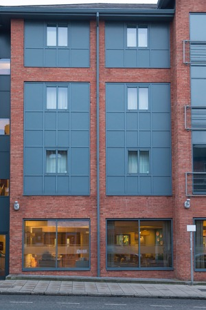 redbrick: Brickwall facade in england Stock Photo