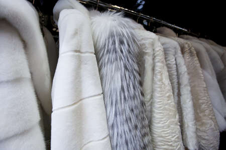 Expensive fur coats for women on coat-hanger