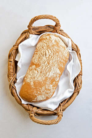 Rustic bread in the bakery basket with napkin