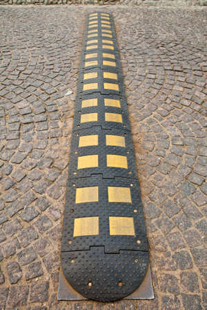 Speed bump on cobbled roadway