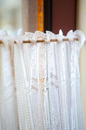 Window curtain in little french restaraunt