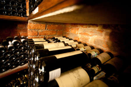 glass of red wine: Wine cellar in small french restaraunt