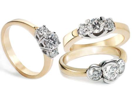 Het verzamelen van Diamond Rings in goud Stockfoto